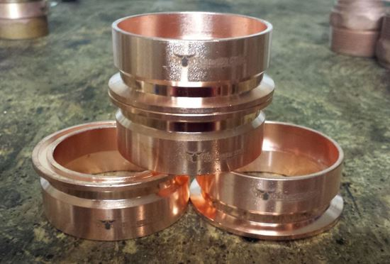 "small stack of Stampede Stills 100% Copper 2"" Distillation Tri-clamp Ferrule/Sanitary Fitting (slip fit)"